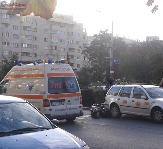 Accident in Marasti! Impact intre un motociclist si un taximetru FOTO