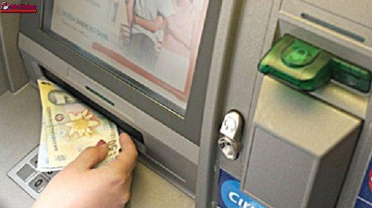 Identificată de polițiști după ce a luat 1.600 de lei dintr-un bancomat, deși nu erau ai ei