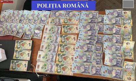 """Escroci prinși de polițiști după ce au luat 60.000 de euro de la o clujeancă prin metoda """"Accidentul"""""""